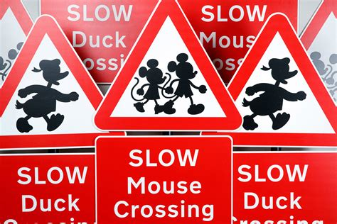 disney themed road signs designed  teach children  safety auto express