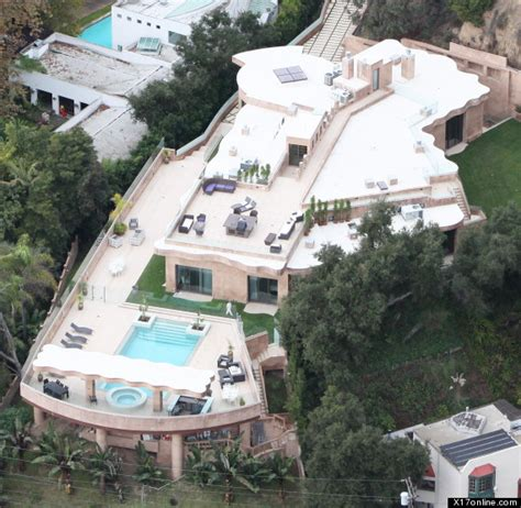 rihanna s 12 million mansion singer buys home in