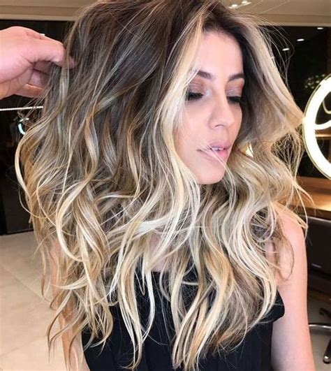 light hair color framing face with brown in back picture of brown hair with blonde balayage plus face