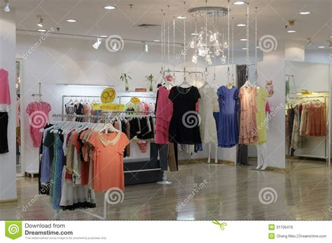 room shopping websites fashion clothing on hangers in the shop editorial
