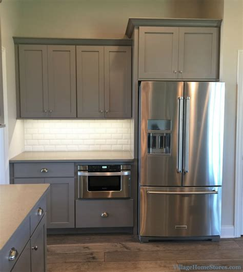 kitchenaid refrigerator and sharp microwave drawer in a