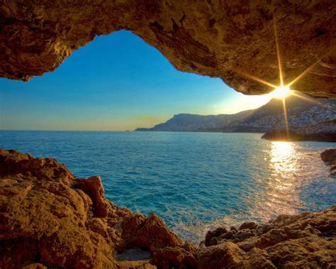 sunset sea cave nature landscape wallpaper preview