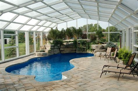 enclosed pool indoor pool setting with our retractable pool enclosures