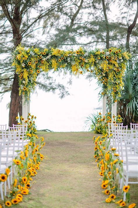 Yellow wedding ceremony (backdrop and aisle) decor with