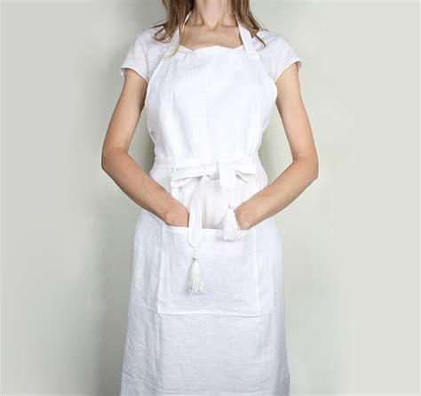 what is an apron front white linen apron with tassles