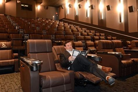 cineplex recliner seats pass the popcorn and calamari vip movie theatre to