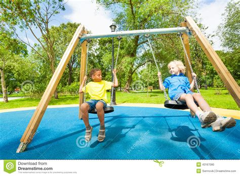 kids swing online india kids on swings staring at each other and sit stock