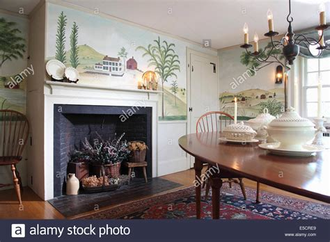 dining room with wall mural of trees and countryside in