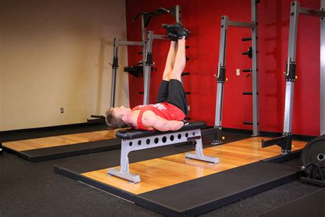 leg raises on bench flat bench lying leg raise exercise guide and video