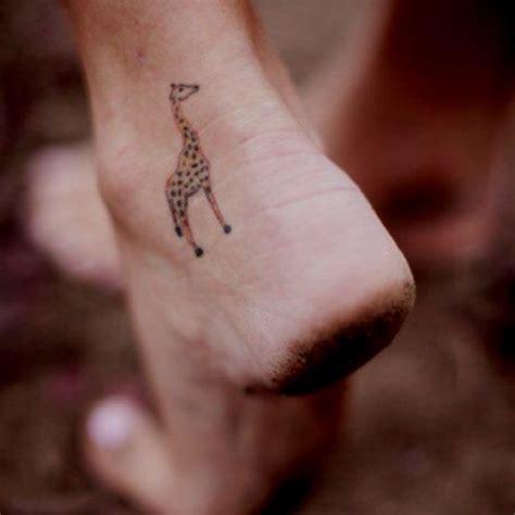 giraffe tattoo behind ear giraffe tattoologist