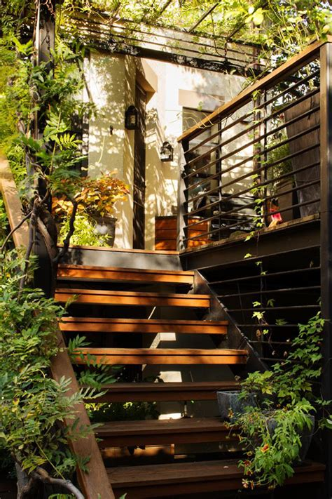 wooden outdoor stairs and landscaping steps on slope amazing over the deck with extra gardening space house