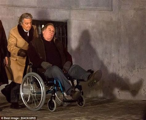gerard depardieu wheelchair g 233 rard depardieu is pushed along in a wheelchair in