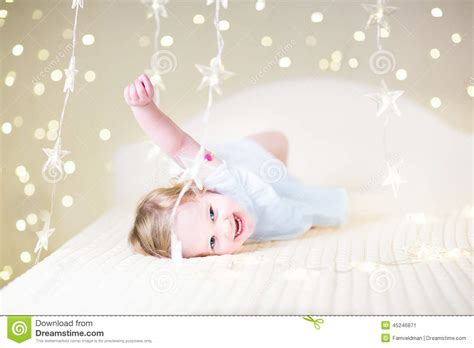 Toddler L by Toddler On A Bed Between Warm Soft