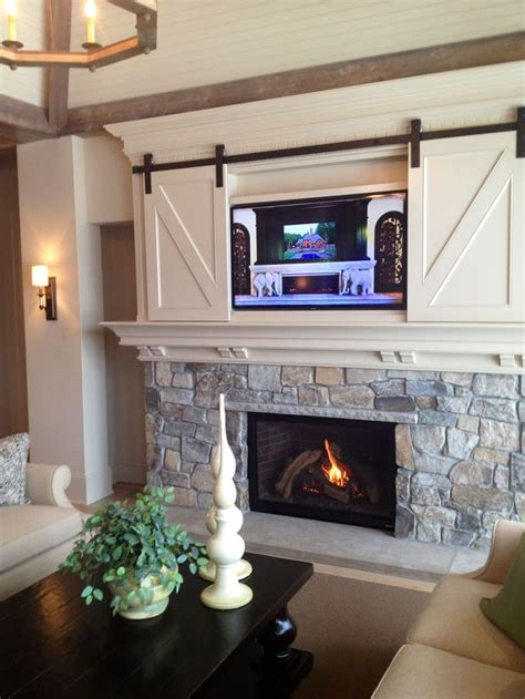 tv above fireplace 25 best ideas about tv above fireplace on tv above mantle neutral downstairs