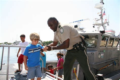 fwc public boat r finder fwc law enforcement an officer helps visitors disembark