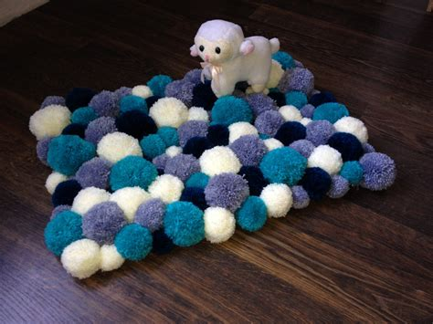 how to make a yarn pom pom rug pom pom rug