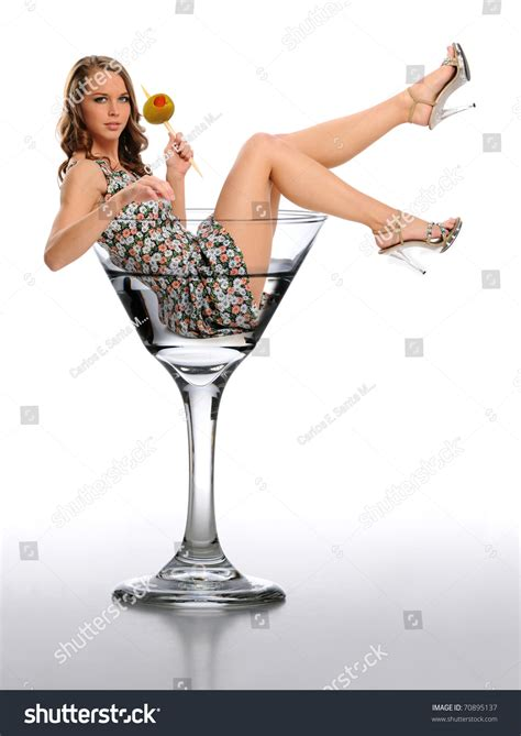 martini woman young woman martini glass holding olive stock photo