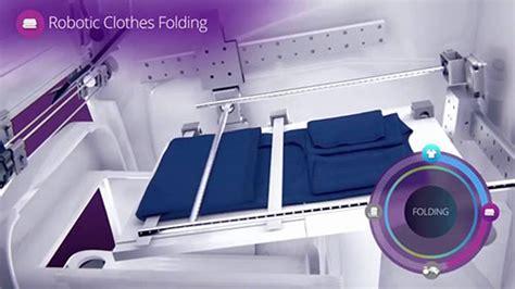 Setrika Dan Gambar canggih mesin ini bisa melipat dan menyetrika pakaian