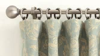 curtain hanging options how to correctly hang a drape at home pottery barn