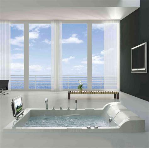 floor to ceiling windows make a splash into your bathroom with floor to ceiling windows