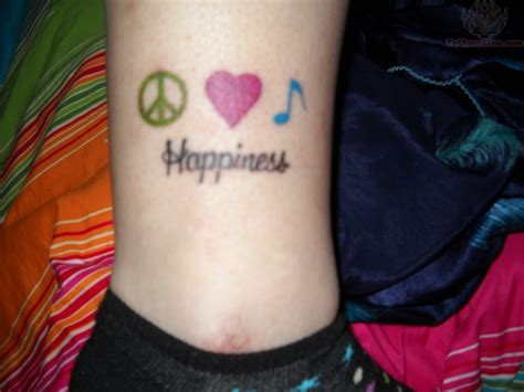 tattoo love peace happiness peace and happiness tattoo on leg