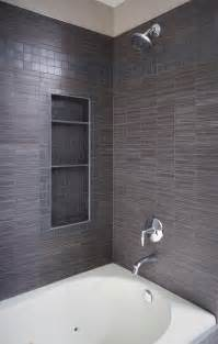 tile shower with storage and polished chrome trim
