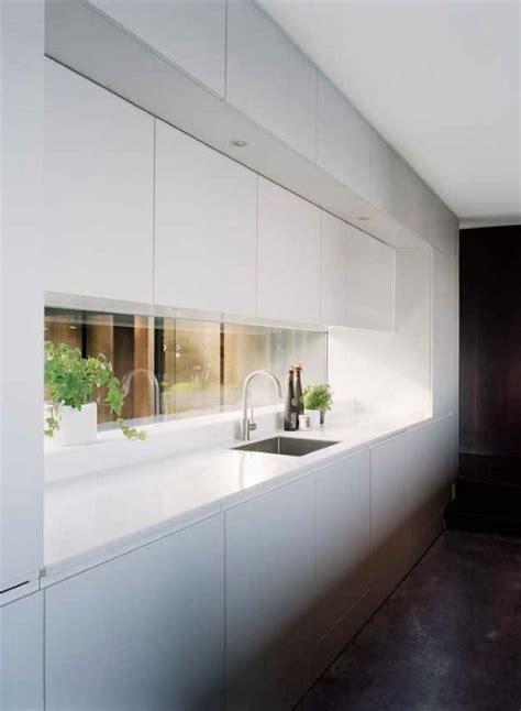 kitchen pendant lights and mirrored tile splashback home the 25 best mirror splashback ideas on pinterest