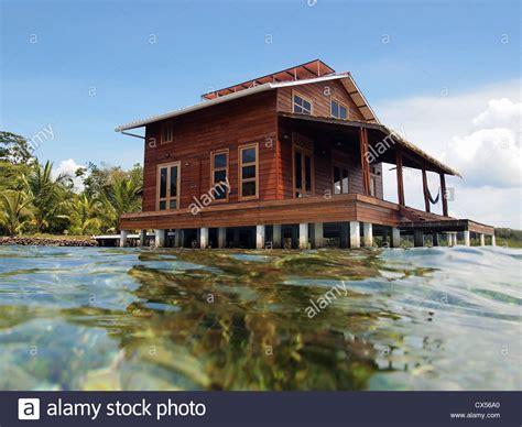 Stilt House Designs tropical stilt house over the caribbean sea stock photo
