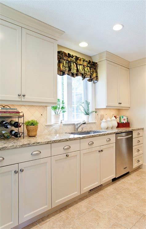 santa cecilia granite countertops white kitchen cabinets