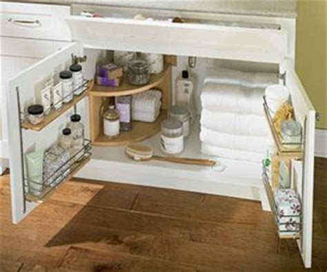 under bathroom sink organization ideas store more in your bath under sink vanities and cabinets