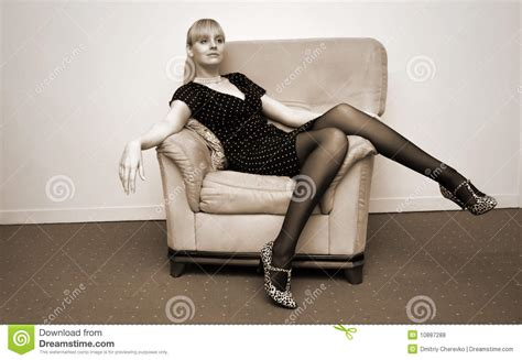 woman in armchair lady in an armchair royalty free stock photos image