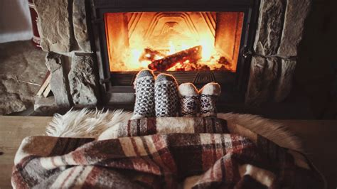 fireplace cozy couple feet in wool socks by the cozy fireplace 4k man