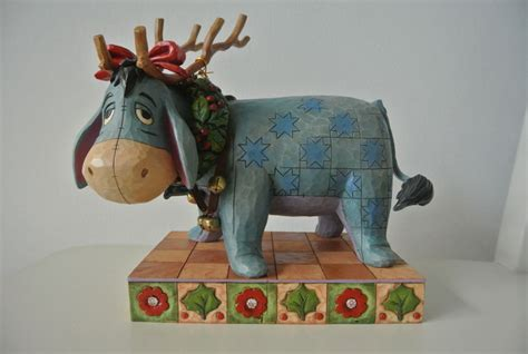 winnie the pooh pottery eeyore with christmas decorations