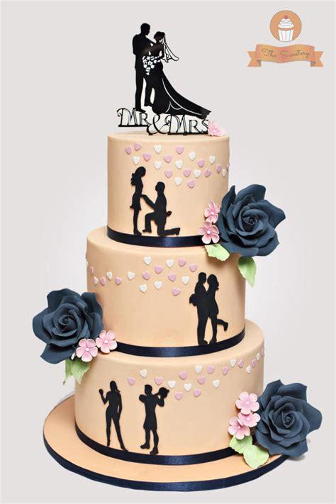 silhouette wedding cake  peach  navy blue cake