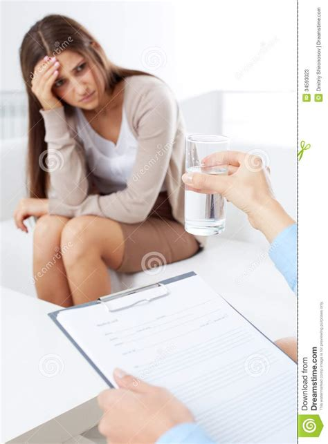 the couch doctor offering water stock photos image 34593023