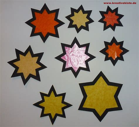 fensterbilder weihnachten sterne basteln fensterbild adventskerzen