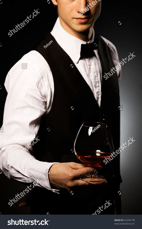 professional waiter serving stock photo