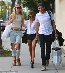 Sarah hyland cuddles up to boyfriend dominic sherwood and lucy fry in