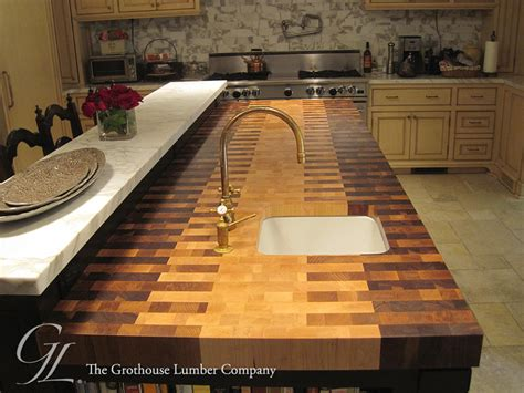 Wainscoting Kitchen Island by Butcher Block Countertop With An Interlocked Pattern