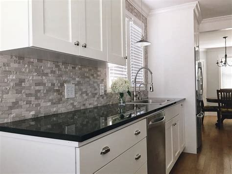 white cabinets black granite what color backsplash 28 white cabinets dark granite countertops make