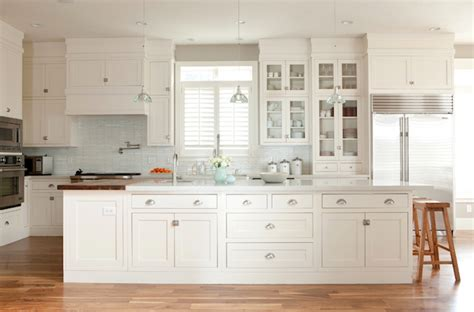 white kitchen shaker cabinets long kitchen island transitional kitchen ashlee