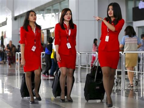 airasia uniform malaysian mps worried airasia s flight attendant uniforms