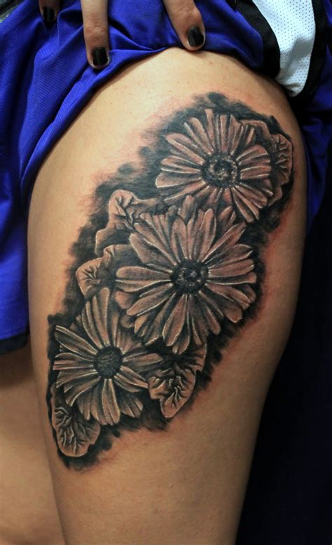 tattoo real flower daisy flower black and grey real tattoo tattoos by