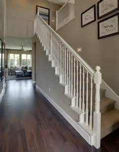 the white banister wood floors and the wall color