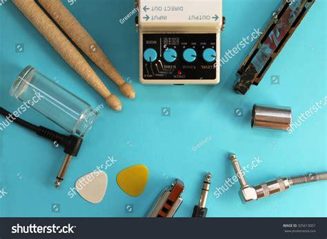 Slide And Soul Drum Stick concept guitar pedals drum sticks stock photo 325613051