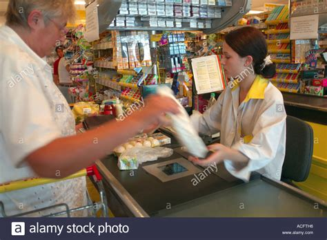 shop assistant at a check out till in kiev ukraine stock photo royalty free image 7511317 alamy