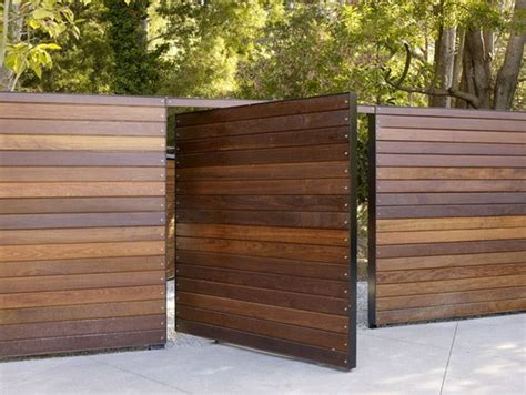 Wooden slat fence and gate home renovations pinterest surface design wood gates and front