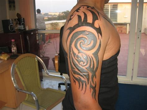 tribal quarter sleeve tattoo pictures tribal half sleeve tattoos
