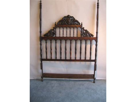 tall wood headboard a tall carved wood headboard with turned posts 1282448