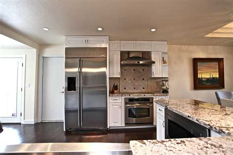 white kitchen cabinets with stainless steel appliances stainless steel appliances granite countertops white